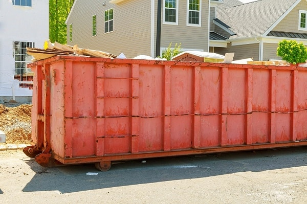 How to avoid overage fees when renting a dumpster